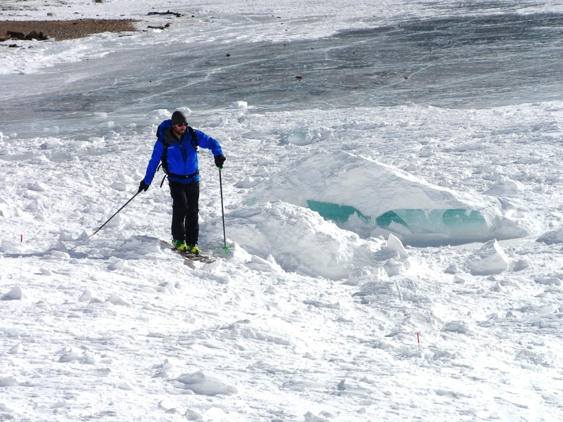 <b>Figure 11:</b> Lake ice block wrapped up in avalanche debris. CAIC forecaster for scale (<a href=javascript:void(0); onClick=win=window.open('https://caic-production.imgix.net/01whegdrwlblpxeu0bpoyaqrf3ci?ixlib=php-3.1.0&s=ebdf5fb5f658023c74f04161e3f54e68','caic_media','resizable=1,height=820,width=840,scrollbars=yes');win.focus();return false;>see full sized image</a>)