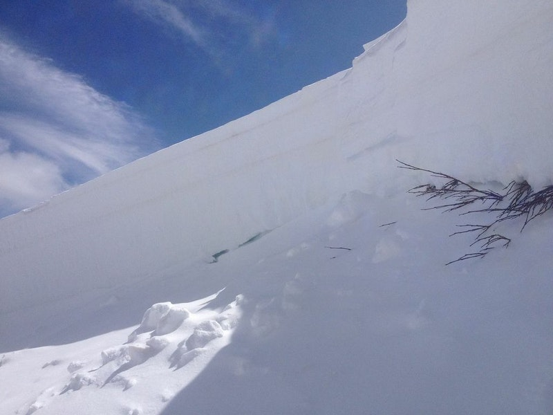 <b>Figure 9:</b> The crown face was only three feet tall on the skier's right (east) side. The cavities indicate very weak snow at the intersection of the bed surface and crown face in this area. (<a href=javascript:void(0); onClick=win=window.open('https://caic-production.imgix.net/26429blde7uvi09rjdsgng1xj2ou?ixlib=php-3.1.0&s=a928e7a960489c42156241d097206998','caic_media','resizable=1,height=820,width=840,scrollbars=yes');win.focus();return false;>see full sized image</a>)