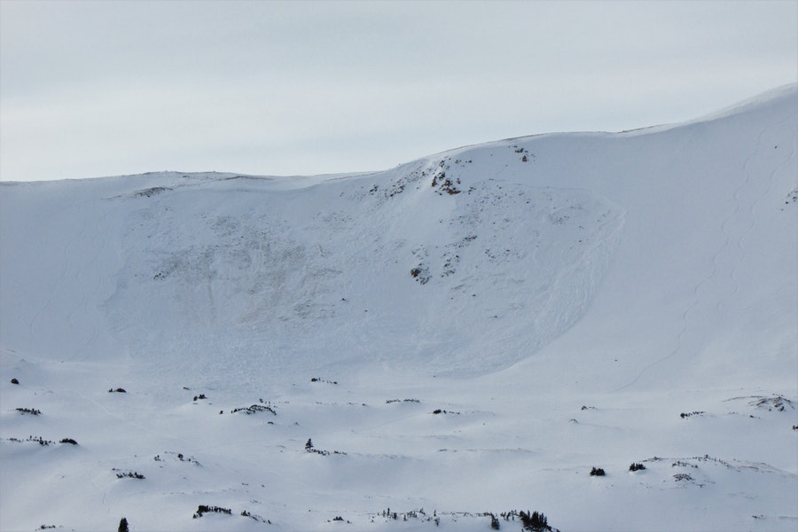 <b>Figure 2:</b> Avalanche on an east aspect above treeline near Loveland Pass, photo taken on 19 Dec 2019.  Trigger is unknown, but there are numerous ski tracks in the immediate vicinity. (<a href=javascript:void(0); onClick=win=window.open('https://caic-production.imgix.net/34o2p3q4kd9gffajrqku1ciegjcd?ixlib=php-3.1.0&s=5e6be45de08edfb2c7c6de6233daeae5','caic_media','resizable=1,height=820,width=840,scrollbars=yes');win.focus();return false;>see full sized image</a>)