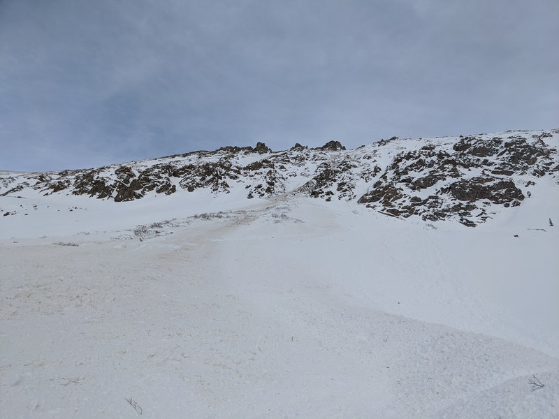 <b>Figure 3:</b> Looking up path from the debris of a snowboarder triggered avalanche near the west portal of the Eisenhower Tunnel, 25 March 2020. (<a href=javascript:void(0); onClick=win=window.open('https://caic-production.imgix.net/4q098379ajdyilg7p0terbj66qxm?ixlib=php-3.1.0&s=a6eb7515630d1751f28418a5eb3d112f','caic_media','resizable=1,height=820,width=840,scrollbars=yes');win.focus();return false;>see full sized image</a>)