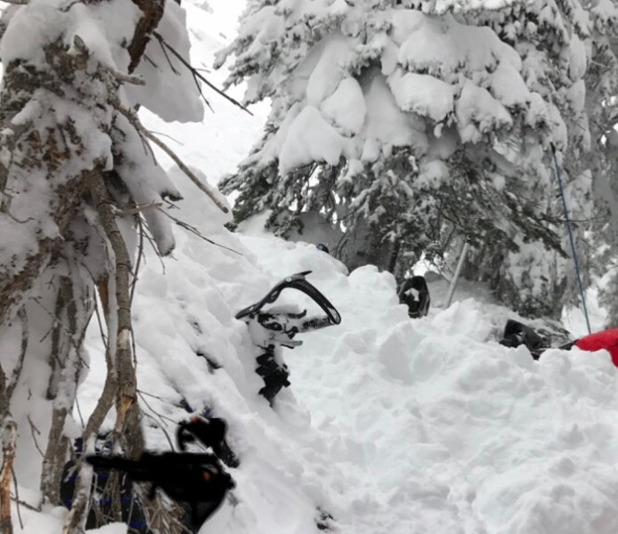 <b>Figure 5:</b> Rider 5's snowmobile after it was partially dug out. (<a href=javascript:void(0); onClick=win=window.open('https://caic-production.imgix.net/6yip1ez41a6xxtdrcilt2vixcatt?ixlib=php-3.1.0&s=5a75f1af30b4d6a41dff90b38a4da288','caic_media','resizable=1,height=820,width=840,scrollbars=yes');win.focus();return false;>see full sized image</a>)