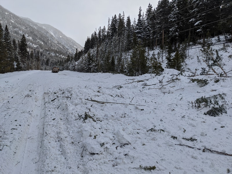 <b>Figure 3:</b> Debris on the frontage road from an avalanche in the Ganley slide path, 10 Feb 2020. (<a href=javascript:void(0); onClick=win=window.open('https://caic-production.imgix.net/71d7oqt70hmg2y3nlw73adze9zbu?ixlib=php-3.1.0&s=9b5050cdfa0a4773c8a71f61d60b3715','caic_media','resizable=1,height=820,width=840,scrollbars=yes');win.focus();return false;>see full sized image</a>)