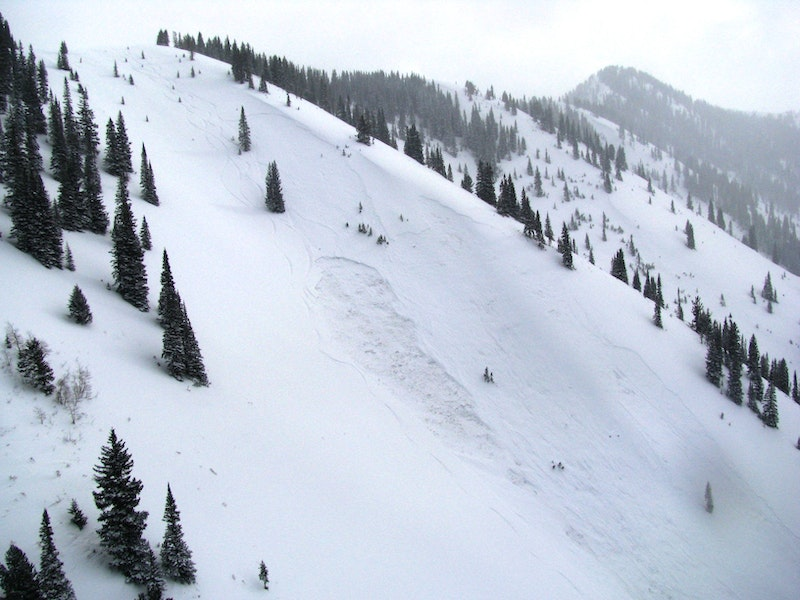<b>Figure 2:</b> West side of Marble Peak ridge and the accident site. 4 ski tracks from the group are on the slope. Crown of storm slab is about 100 vertical feet above the smaller, but deeper persistent slab. (<a href=javascript:void(0); onClick=win=window.open('https://caic-production.imgix.net/73fx2mcinqqijng3xsxxm3yw93k7?ixlib=php-3.1.0&s=e3c7912b4efa3e470fa268713185de27','caic_media','resizable=1,height=820,width=840,scrollbars=yes');win.focus();return false;>see full sized image</a>)