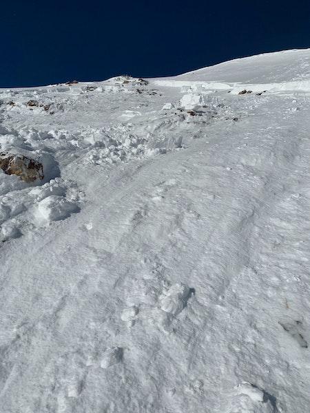 <b>Figure 3:</b> Looking from the bed surface up towards the crown of a skier triggered avalanche in Red Lady Bowl on November 25. The image was taken by Skier 3 while entering the path on the bed surface. (<a href=javascript:void(0); onClick=win=window.open('https://caic-production.imgix.net/7as5cvd8j0wfyje4kl744sz9mrri?ixlib=php-3.1.0&s=9c9622e422a64e03a7d961b7fa0653b1','caic_media','resizable=1,height=820,width=840,scrollbars=yes');win.focus();return false;>see full sized image</a>)