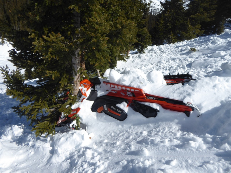 <b>Figure 4:</b> Rider 2's snowmobile was stuck in the stand of trees. (<a href=javascript:void(0); onClick=win=window.open('https://caic-production.imgix.net/822hg59tbuwir54xcz625lup4j3q?ixlib=php-3.1.0&s=2372646b814a858841995b5b281ad9d9','caic_media','resizable=1,height=820,width=840,scrollbars=yes');win.focus();return false;>see full sized image</a>)