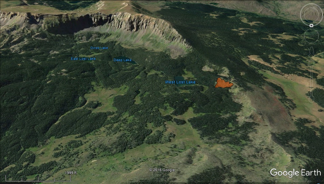 <b>Figure 2:</b> A Google Earth image looking south at Lost Lake Peaks. The avalanche is shown in red to the right of West Lost Lake. (<a href=javascript:void(0); onClick=win=window.open('https://caic-production.imgix.net/865420brz6fiq95u9phejzdy3ikx?ixlib=php-3.1.0&s=a80837a684366a6d138cb747d2cc0c1f','caic_media','resizable=1,height=820,width=840,scrollbars=yes');win.focus();return false;>see full sized image</a>)