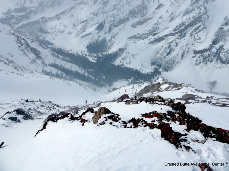 <b>Figure 2:</b> Looking downhill at the slide path, near where the group started their ski descent and triggered the avalanche. (<a href=javascript:void(0); onClick=win=window.open('https://caic-production.imgix.net/8j4mwbd2f33laqle56567xym9cb5?ixlib=php-3.1.0&s=5b7a53fd248d72dc21c178c052cde7f6','caic_media','resizable=1,height=820,width=840,scrollbars=yes');win.focus();return false;>see full sized image</a>)