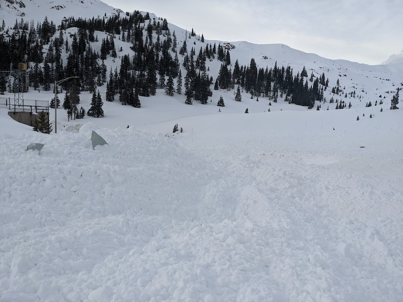 <b>Figure 2:</b> Debris on the Loop Road from a snowboarder triggered avalanche near the west portal of the Eisenhower Tunnel, 25 March 2020. (<a href=javascript:void(0); onClick=win=window.open('https://caic-production.imgix.net/b4mrn85c13s9t834e0x7p2y9dix4?ixlib=php-3.1.0&s=4911823b0e3c23a1f118357a6907f380','caic_media','resizable=1,height=820,width=840,scrollbars=yes');win.focus();return false;>see full sized image</a>)
