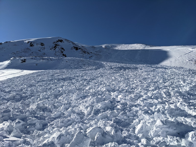 <b>Figure 4:</b> Looking up at a very large snowmobile-triggered avalanche at Jones Pass on 1/8/21. East-facing slope. The snowmobiler miraculously escaped uninjured. (<a href=javascript:void(0); onClick=win=window.open('https://caic-production.imgix.net/be4pqm178r0say8oje2k7crla1fs?ixlib=php-3.1.0&s=147e9b26f2b385e02a22fc236a42bf6c','caic_media','resizable=1,height=820,width=840,scrollbars=yes');win.focus();return false;>see full sized image</a>)