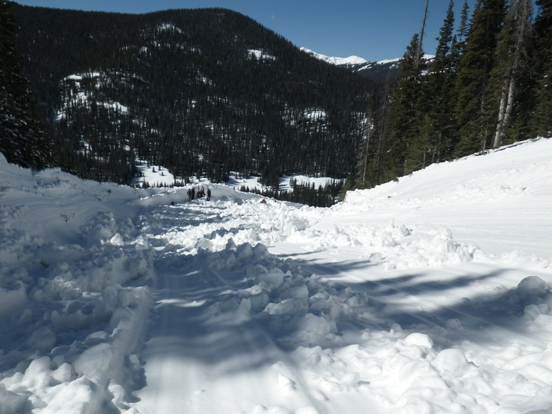 <b>Figure 11:</b> Looking downhill at the final turn of the avalanche debris. (<a href=javascript:void(0); onClick=win=window.open('https://caic-production.imgix.net/e0dyqqwtsh24hptylpbsjsbfrsg3?ixlib=php-3.1.0&s=6d46f464b4f9a65ab5d769e9ffd5e22b','caic_media','resizable=1,height=820,width=840,scrollbars=yes');win.focus();return false;>see full sized image</a>)