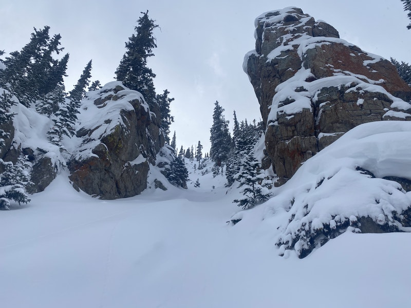<b>Figure 5:</b> Looking up Chimney Chute from the apron of the avalanche path. This image was taken on December 27, 2020, after seven inches of snow had fallen. (<a href=javascript:void(0); onClick=win=window.open('https://caic-production.imgix.net/fhtubchbb1uwyq3ux3gsycojasfp?ixlib=php-3.1.0&s=1c66bc446e0adf68a0ba5dedf0014925','caic_media','resizable=1,height=820,width=840,scrollbars=yes');win.focus();return false;>see full sized image</a>)