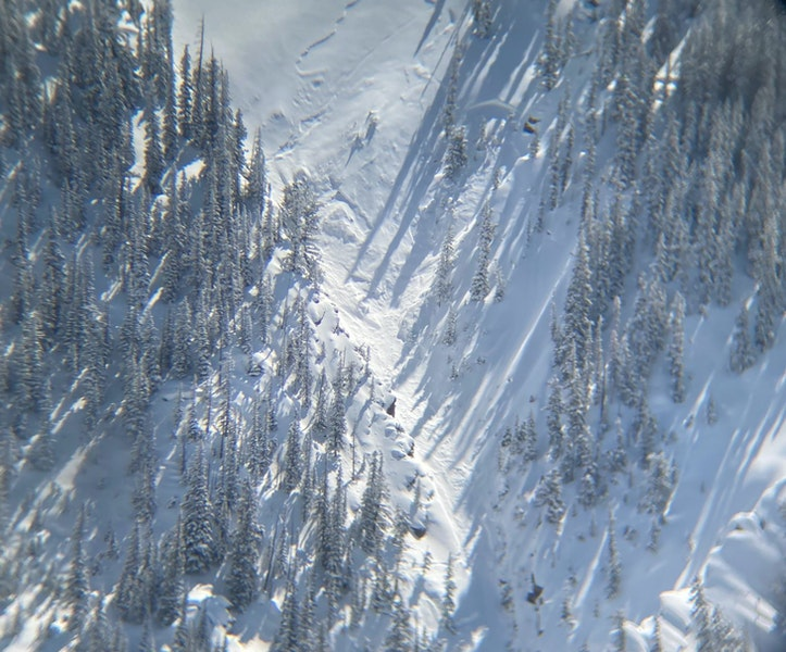 <b>Figure 5:</b> View of the starting zone. The shallow crown at the top of the image is from the small avalanche triggered by Skier 2 during the rescue. The deeper crown in the trees is from the avalanche triggered by Skier 1. (<a href=javascript:void(0); onClick=win=window.open('https://caic-production.imgix.net/fpui5lvwti6xp41esvt7oqng4wfd?ixlib=php-3.1.0&s=e293d6af64b36655f3e422f948564b0d','caic_media','resizable=1,height=820,width=840,scrollbars=yes');win.focus();return false;>see full sized image</a>)