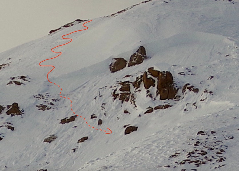 <b>Figure 3:</b> Looking up at the crown of the avalanche. The red curve shows the approximate location of Skier 1's descent. (Courtesy of Dale Atkins). (<a href=javascript:void(0); onClick=win=window.open('https://caic-production.imgix.net/g07lo99q3esk79tr3ve8u0ooir1z?ixlib=php-3.1.0&s=de7b91b4c04671f5969af51b7d04e008','caic_media','resizable=1,height=820,width=840,scrollbars=yes');win.focus();return false;>see full sized image</a>)