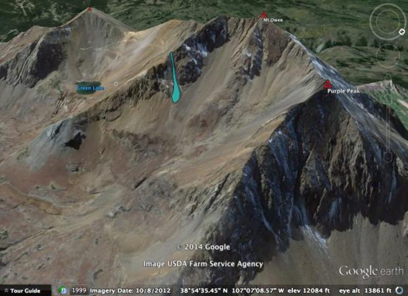 <b>Figure 1:</b> Google Earth image, looking southwest at Mt Owen. The location and size of the avalanche is marked in blue. (<a href=javascript:void(0); onClick=win=window.open('https://caic-production.imgix.net/g0v856pf6jilcme7bcl7e3e986uy?ixlib=php-3.1.0&s=dce8e0b41554c1de73c1be9d79de11e4','caic_media','resizable=1,height=820,width=840,scrollbars=yes');win.focus();return false;>see full sized image</a>)