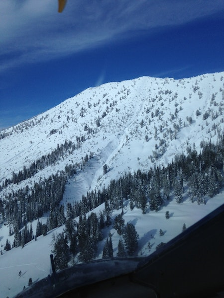 <b>Figure 1:</b> The avalanche ran on the sparsely treed slope and into the gully in the middle of the photograph. (<a href=javascript:void(0); onClick=win=window.open('https://caic-production.imgix.net/gbwmxflorghhk9c8tts108rx5lcy?ixlib=php-3.1.0&s=0b81b4fbac5e4f61e7e75c2ac1f72cb6','caic_media','resizable=1,height=820,width=840,scrollbars=yes');win.focus();return false;>see full sized image</a>)