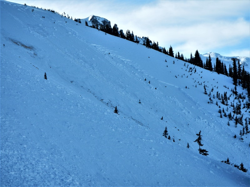 <b>Figure 6:</b> Investigators estimated the avalanche crown face around two feet at the deepest point on the climber's right or west side. (<a href=javascript:void(0); onClick=win=window.open('https://caic-production.imgix.net/he9aemt4iofta0tijfyxhi4mjewh?ixlib=php-3.1.0&s=bb15782e4b818f9608c2df8482c122c0','caic_media','resizable=1,height=820,width=840,scrollbars=yes');win.focus();return false;>see full sized image</a>)