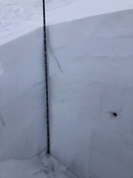 <b>Figure 9:</b> This image shows a crack in the snow triggered as investigators traveled through the undisturbed snow near the accident site. Investigators triggered whumpfs and shooting cracks on December 20. Snowpit tests conducted during the investigation indicated a high potential for crack propagation under the recent snow (ECTP12, ECT20) (<a href=javascript:void(0); onClick=win=window.open('https://caic-production.imgix.net/imdiqwrzvnvm7f9lw4oupy8ks54g?ixlib=php-3.1.0&s=6cddc65e668616598d9ffdd6b671ab7f','caic_media','resizable=1,height=820,width=840,scrollbars=yes');win.focus();return false;>see full sized image</a>)