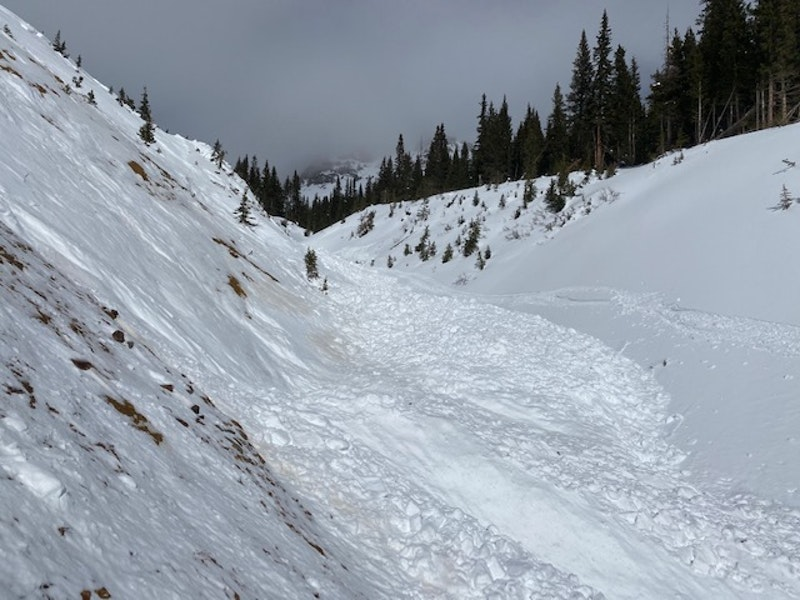 <b>Figure 5:</b> Looking west, up the gully, from near the spot where the group probably triggered the avalanche. (<a href=javascript:void(0); onClick=win=window.open('https://caic-production.imgix.net/k8zaqzyukrse8aawritoi8p7ggc9?ixlib=php-3.1.0&s=90e9a23df761a79e0d3c31bc88c5c450','caic_media','resizable=1,height=820,width=840,scrollbars=yes');win.focus();return false;>see full sized image</a>)