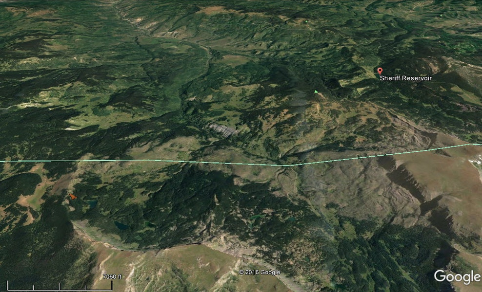 <b>Figure 1:</b> A Google Earth image of the area looking to the north toward Sheriff Reservoir. The turquoise line is the border between Rio Blanco and Garfield counties. The avalanche is shown in red in the lower left portion of the frame. (<a href=javascript:void(0); onClick=win=window.open('https://caic-production.imgix.net/l0lsv5qmd0d1qg9nn8etsaiuf9ct?ixlib=php-3.1.0&s=918bbe4e9ec07c79db3ec8dcf1ed3ae7','caic_media','resizable=1,height=820,width=840,scrollbars=yes');win.focus();return false;>see full sized image</a>)
