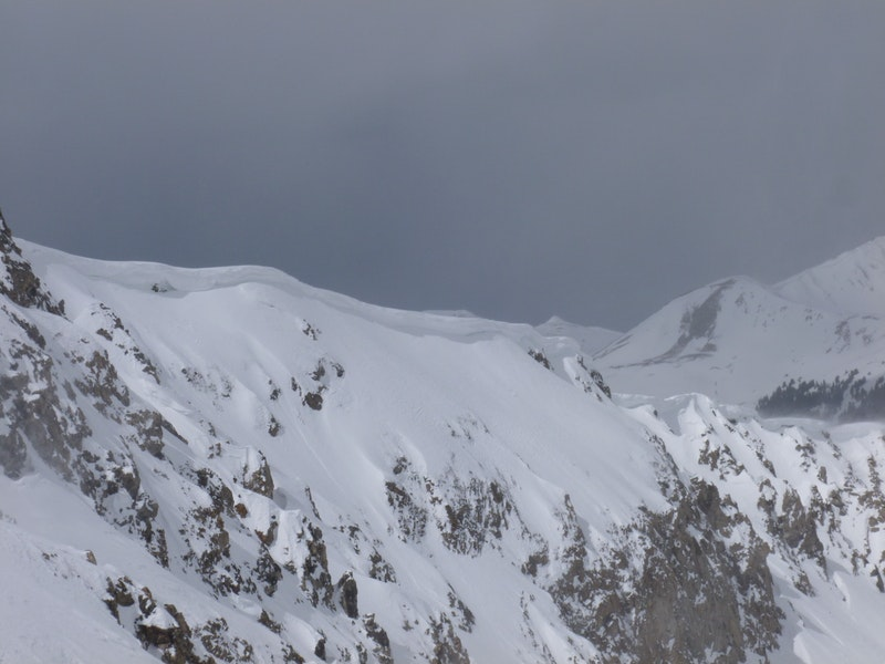 <b>Figure 1:</b> Cornices are growing and may collapse with a person's weight. We will need to give these cornices a wide berth. A cornice collapse could result in a long fall and could also trigger a subsequent avalanche on the slope. (<a href=javascript:void(0); onClick=win=window.open('https://caic-production.imgix.net/l5ztrg2xzanpdz7t7r2w8z2ozgt7?ixlib=php-3.1.0&s=77f836d9f1d2b7f0e8081b17894fb844','caic_media','resizable=1,height=820,width=840,scrollbars=yes');win.focus();return false;>see full sized image</a>)