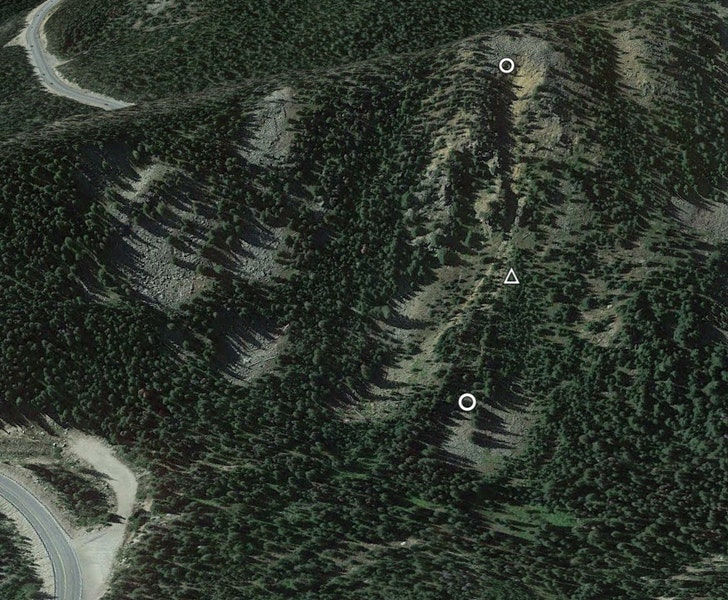 <b>Figure 2:</b> An overview of the accident site in Google Earth. The white circles mark the crown face of the avalanche and toe of the debris. The white triangle marks the location of Skier 1's burial. (<a href=javascript:void(0); onClick=win=window.open('https://caic-production.imgix.net/lzf87bhdip5lk4s0pu6vyf9t3d41?ixlib=php-3.1.0&s=f63d5e7f1c731b04e1dc7935dc48645e','caic_media','resizable=1,height=820,width=840,scrollbars=yes');win.focus();return false;>see full sized image</a>)