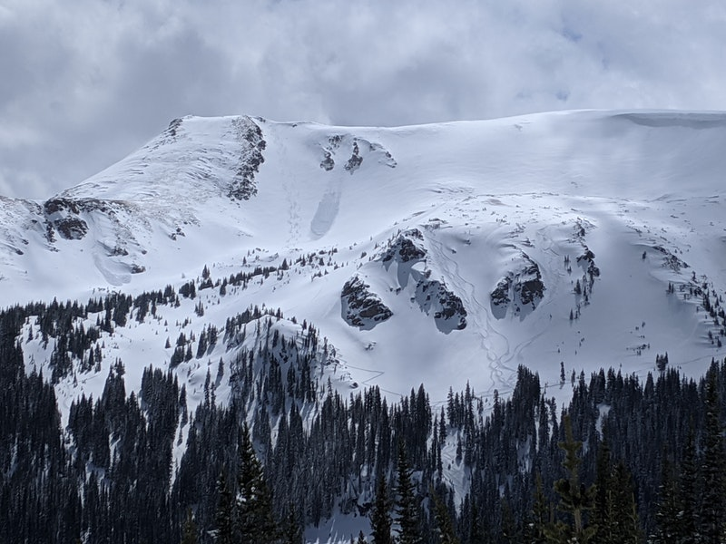 """<b>Figure 1:</b> Three of the four avalanches are pictured here (left, center, and right in the """"XYZ Chutes."""" The largest in the center caught and carried a skier after three skiers descended to the looker's left. (<a href=javascript:void(0); onClick=win=window.open('https://caic-production.imgix.net/n0v22tslz8ph19fu0nl6f5g3pd9s?ixlib=php-3.1.0&s=f6542e15d02a2d43fb6510e39136641d','caic_media','resizable=1,height=820,width=840,scrollbars=yes');win.focus();return false;>see full sized image</a>)"""