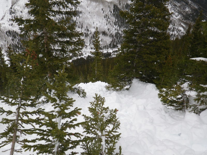 <b>Figure 15:</b> Looking down hill at avalanche debris. The image was taken uphill and to the east (skier's right) of were Riders 2 and 4 were buried. (<a href=javascript:void(0); onClick=win=window.open('https://caic-production.imgix.net/pclg47xumlkbtbur7srjvrd4ix6s?ixlib=php-3.1.0&s=c731ff36ca6b1d93b47d59de5f3b5f4d','caic_media','resizable=1,height=820,width=840,scrollbars=yes');win.focus();return false;>see full sized image</a>)