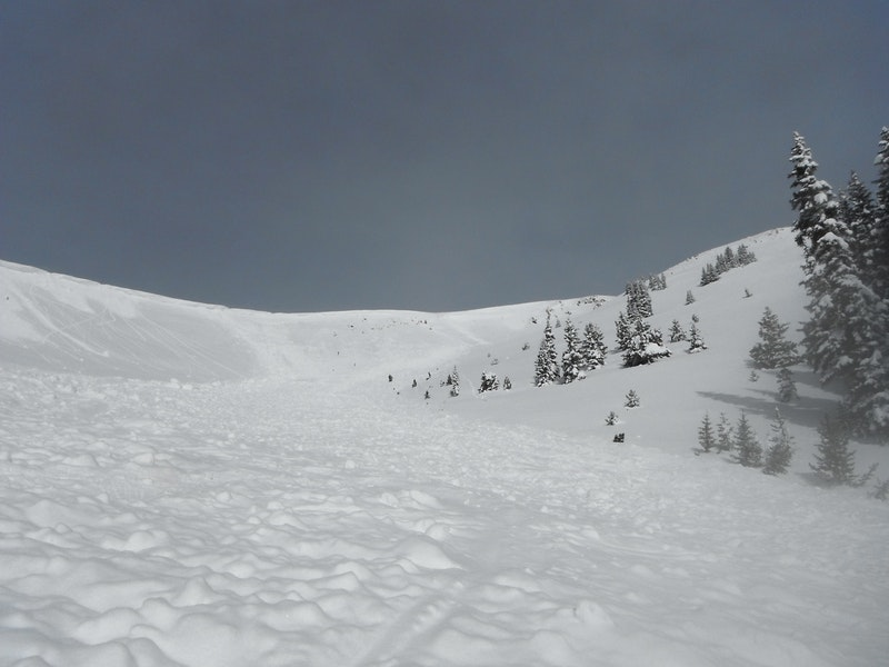 <b>Figure 4:</b> Looking uphill at the avalanche triggered by Group 2. (<a href=javascript:void(0); onClick=win=window.open('https://caic-production.imgix.net/trm03sbcgv6sb92fv54xkxb8q6rs?ixlib=php-3.1.0&s=199c09ff9be964d3140e05f0f11c64eb','caic_media','resizable=1,height=820,width=840,scrollbars=yes');win.focus();return false;>see full sized image</a>)