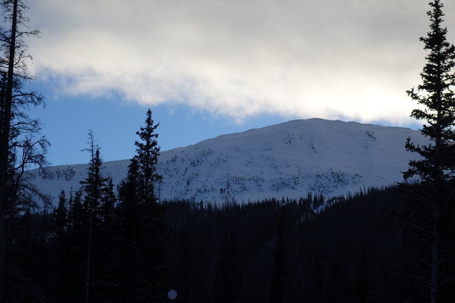 <b>Figure 1:</b> Looking up at South Diamond Peak, NE face, from the highway. The entire face slid on 12-24-2016. This is a very large and very scary avalanche. There are definitely other faces in the Front Range Zone with a similar structure that can produce equally large and dangerous avalanches. (<a href=javascript:void(0); onClick=win=window.open('https://caic-production.imgix.net/u10cs4fukjrrzbzqwcslemd68m4j?ixlib=php-3.1.0&s=eaf0122bf2935e494fbeb0123a0e6796','caic_media','resizable=1,height=820,width=840,scrollbars=yes');win.focus();return false;>see full sized image</a>)