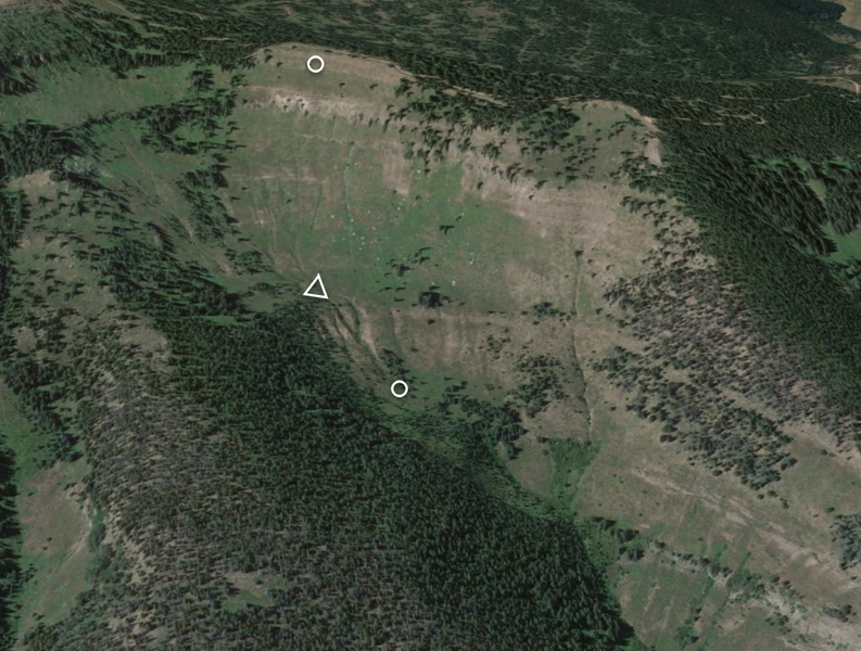 <b>Figure 2:</b> An overview of the accident site in Google Earth. North is to the right of the image. The white circles mark the approximate locations of the avalanche's crown face and toe of the debris. The white triangle marks the approximate location of Skier 1's burial. (<a href=javascript:void(0); onClick=win=window.open('https://caic-production.imgix.net/u6ody18wx8r0laclica33jbw9t5o?ixlib=php-3.1.0&s=7f44e301447a17f4a5a690743b1881d9','caic_media','resizable=1,height=820,width=840,scrollbars=yes');win.focus();return false;>see full sized image</a>)