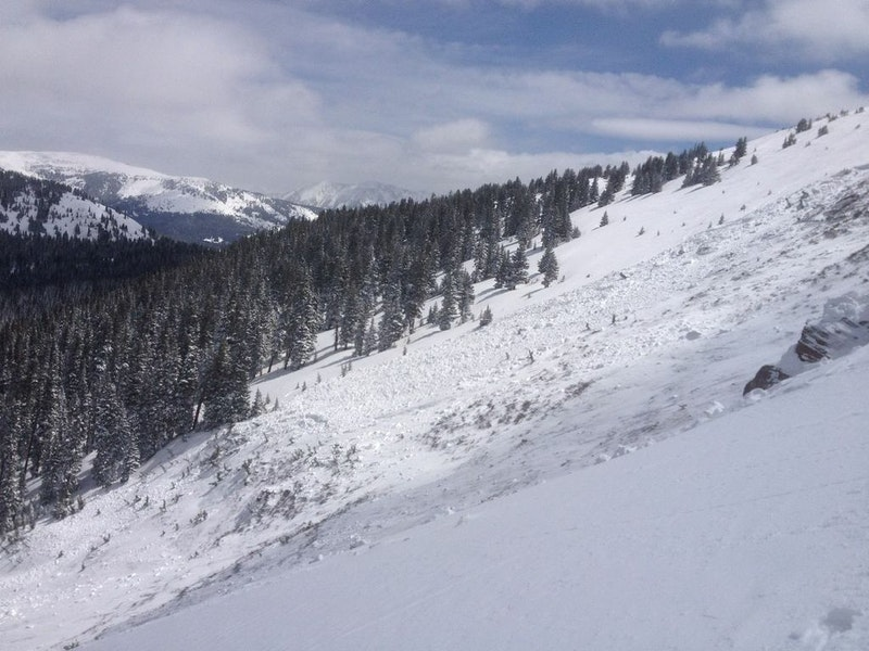<b>Figure 13:</b> Some of the debris stopped on this bench, part way down the avalanche path on the skier's right (east) side. Rider 1 rode out of the avalanche in this area. (<a href=javascript:void(0); onClick=win=window.open('https://caic-production.imgix.net/w33joguxyhk3cxanjbqgpoxn7mzi?ixlib=php-3.1.0&s=ce67bdbeb076c4164a0d6a67feb2e68f','caic_media','resizable=1,height=820,width=840,scrollbars=yes');win.focus();return false;>see full sized image</a>)