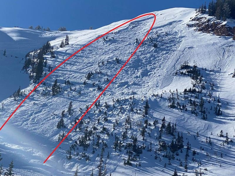 <b>Figure 1:</b> Photo of avalanche path with skier's tracks entering the crown. The avalanche crown to looker's right was triggered with explosives. (<a href=javascript:void(0); onClick=win=window.open('https://caic-production.imgix.net/w54oyctm7s3n0nnp1qqa1at9ltgc?ixlib=php-3.1.0&s=17da1a3c333c699fddc879fd0137f887','caic_media','resizable=1,height=820,width=840,scrollbars=yes');win.focus();return false;>see full sized image</a>)