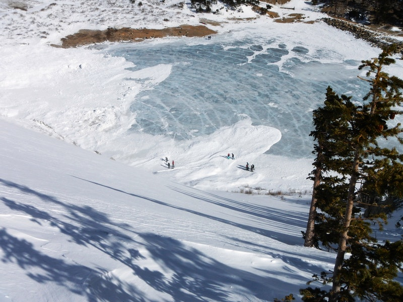 """<b>Figure 1:</b> Looking down at avalanche debris that ran onto the lake. St. Mary's glacier. Note the concentric """"pressure wave"""" rings in the ice out from debris piles. 1.16.16 (<a href=javascript:void(0); onClick=win=window.open('https://caic-production.imgix.net/wdhv9ix0udcnu1mwzk7y89d159cd?ixlib=php-3.1.0&s=2d39267fe72d2c7a7ed347f4fe897cdc','caic_media','resizable=1,height=820,width=840,scrollbars=yes');win.focus();return false;>see full sized image</a>)"""