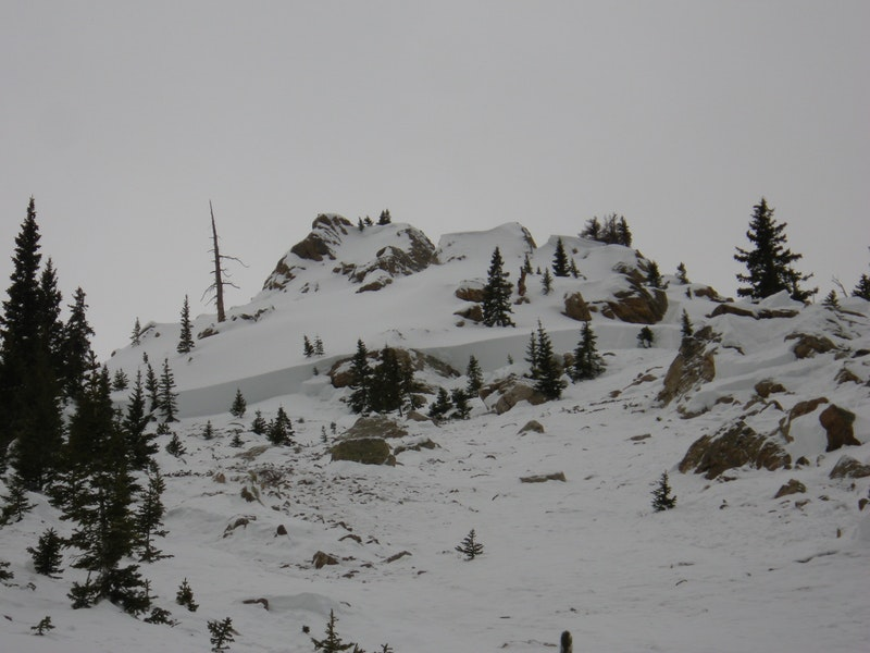 <b>Figure 6:</b> Looking up will at a deep portion of the crown face in the eastern portion of the Star Mountain A avalanche path. The group's snowpit is behind the trees in the left side of the image. (<a href=javascript:void(0); onClick=win=window.open('https://caic-production.imgix.net/wewzzq0ovocbonl6rfhxrz7jkgck?ixlib=php-3.1.0&s=cb1b6ea6e46f70c61d2cbc3894de1d9c','caic_media','resizable=1,height=820,width=840,scrollbars=yes');win.focus();return false;>see full sized image</a>)