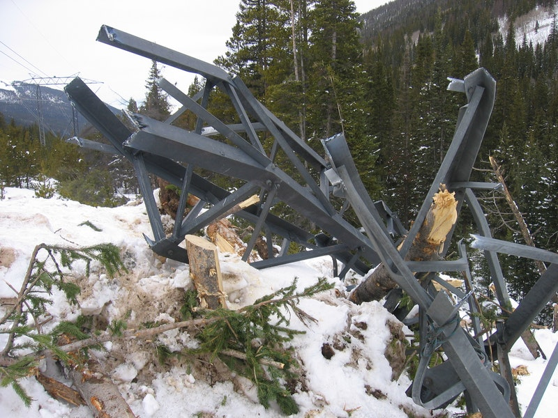 <b>Figure 3:</b> A power line tower destroyed by the avalanche. (<a href=javascript:void(0); onClick=win=window.open('https://caic-production.imgix.net/wkh2w56o2hl48movz1xm1bbr42vy?ixlib=php-3.1.0&s=99f3250c38f0a7d59cddde23f1465638','caic_media','resizable=1,height=820,width=840,scrollbars=yes');win.focus();return false;>see full sized image</a>)