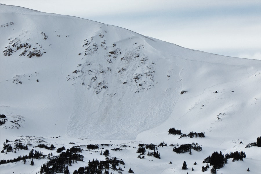<b>Figure 1:</b> Snowboarder triggered avalanche on and east aspect above treeline near Loveland Pass, 19 Dec 2019.  The rider's track into the avalanche is visisble in the top center of the crown. (<a href=javascript:void(0); onClick=win=window.open('https://caic-production.imgix.net/wqqfkx2trymlm7zcvyflonze55aa?ixlib=php-3.1.0&s=58c76ad2f58d5f153bf32bfdaff33701','caic_media','resizable=1,height=820,width=840,scrollbars=yes');win.focus();return false;>see full sized image</a>)