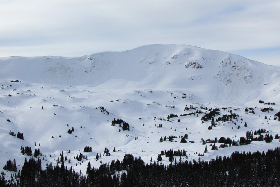 <b>Figure 3:</b> Overview of two avalanches, one of which was snowboarder triggered, on an east aspect above treeline near Loveland Pass, 19 Dec 2019.  Numerous ski tracks are in the vicinity of both slides. (<a href=javascript:void(0); onClick=win=window.open('https://caic-production.imgix.net/wxdr0brh8f9d58ufjkfydgs31bij?ixlib=php-3.1.0&s=dacd7b8046b173702a134094a07e7772','caic_media','resizable=1,height=820,width=840,scrollbars=yes');win.focus();return false;>see full sized image</a>)