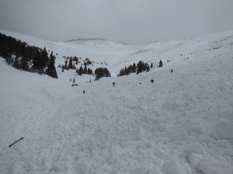 <b>Figure 12:</b> Looking up through the avalanche debris with rescuers in the path. Photo: Halsted Morris (<a href=javascript:void(0); onClick=win=window.open('https://caic-production.imgix.net/xd9pp4v2kv45geuqr1ns1krv4p6b?ixlib=php-3.1.0&s=7b8aae2ae6f4ae87df3e1f1b8cd1fbf4','caic_media','resizable=1,height=820,width=840,scrollbars=yes');win.focus();return false;>see full sized image</a>)
