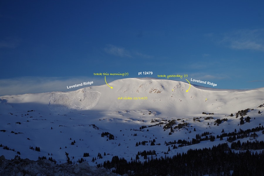 <b>Figure 4:</b> [Dale Atkins/Alpine Rescue Team photo and annotation] The first picture (below) is from 0800 this morning, and it shows a very fresh slide most likely triggered this morning. Though I have a question mark next to it, I am quite sure it was made this morning. Zooming in to the looker's right is a rider's track. Suspect this rider was the trigger from down low in the path. At some point during the day, another rider descended very close to track.   In the photo below, as you go NE along the ridge you'll see another track, but it is not as fresh looking, so I figure it was likely made yesterday. Right where this track was made was where today's avalanche occurred. (<a href=javascript:void(0); onClick=win=window.open('https://caic-production.imgix.net/xgazdjmm7rjoh6ad0azpt592xgxc?ixlib=php-3.1.0&s=d08f0ca374540b4326ef6e39ac054b60','caic_media','resizable=1,height=820,width=840,scrollbars=yes');win.focus();return false;>see full sized image</a>)