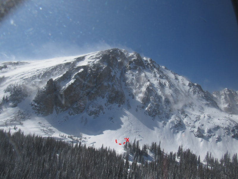 <b>Figure 2:</b> Oh What Big Eyes You Have couloir is in the center of the picture. The red X marks the resting place of Skier 1. The dashed red lines indicate the approximate extent of the avalanche debris. (<a href=javascript:void(0); onClick=win=window.open('https://caic-production.imgix.net/y1s7kqc9ayi4xprb4jqxd5a733pi?ixlib=php-3.1.0&s=748d2c22799093f297abc25f06050ce4','caic_media','resizable=1,height=820,width=840,scrollbars=yes');win.focus();return false;>see full sized image</a>)