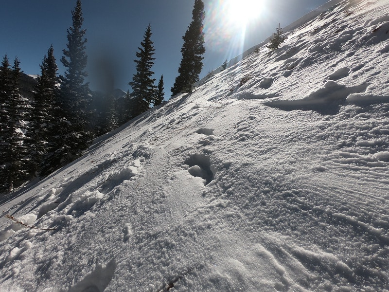 <b>Figure 5:</b> Bed surface with a trace of new snow. The remaining snow is quite shallow and investigators had to kick steps in the hard snow, but would then sink to the ground. (<a href=javascript:void(0); onClick=win=window.open('https://caic-production.imgix.net/yvl2dvi6xz2fixihup8h3g4thbj5?ixlib=php-3.1.0&s=6b014d105d6c8a9435a817c359fb121b','caic_media','resizable=1,height=820,width=840,scrollbars=yes');win.focus();return false;>see full sized image</a>)