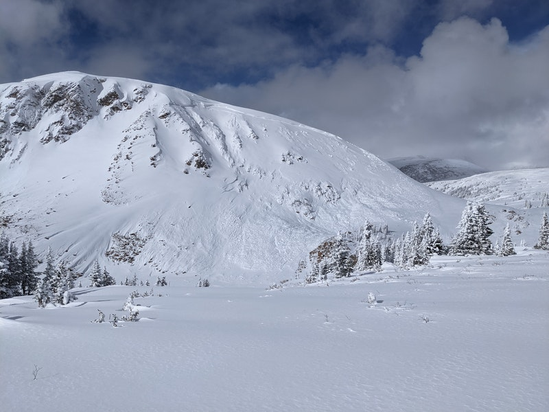 <b>Figure 7:</b> The avalanche wrapped far around the south face of Mount Epworth. Pumphouse Lake is out of view over the looker's right shoulder of Mount Epworth. Image taken on February 16, after additional snow and drifting. Image courtesy GCSAR. (<a href=javascript:void(0); onClick=win=window.open('https://caic-production.imgix.net/zpzraj9yrp0f9jk50jg2bzymqtd0?ixlib=php-3.1.0&s=d3426a09ba6d905f4f9c283c8551a150','caic_media','resizable=1,height=820,width=840,scrollbars=yes');win.focus();return false;>see full sized image</a>)